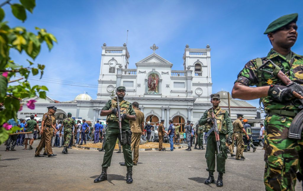 Sri Lankan military officers stand guard in front of the St Anthony's Church where an explosion took place in Kochchikade, Colombo, Sri Lanka, on April 21, 2019.- At least 217 people were killed in Sri Lanka on April 21 when a string of blasts ripped through high-end hotels and churches as worshippers attended Easter services. (Photo by Tharaka Basnayaka/NurPhoto)