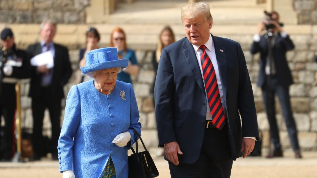 """US President Donald Trump (R) and Britain's Queen Elizabeth II (L) leave the Quadrangle after inspecting a Guard of Honour during a ceremonial welcome at Windsor Castle in Windsor, west of London, on July 13, 2018 on the second day of Trump's UK visit. - US President Donald Trump on Friday played down his extraordinary attack on Britain's plans for Brexit, praising Prime Minister Theresa May and insisting bilateral relations """"have never been stronger"""", even as tens of thousands protested in London against his visit. (Photo by Chris Jackson / POOL / AFP)"""