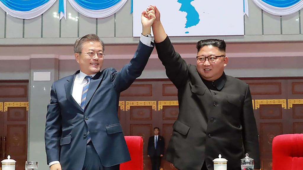 """This picture taken on September 19, 2018 and released by Korean Central News Agency (KCNA) via KNS shows South Korean President Moon Jae-in (L) and North Korean leader Kim Jong Un gesturing during a 'mass games' gymnastic and artistic performance at the May Day Stadium in Pyongyang. - Kim Jong Un and Moon Jae-in visited the spiritual birthplace of the Korean nation on September 20 for a show of unity after their North-South summit gave new momentum to Pyongyang's negotiations with Washington. (Photo by KCNA VIA KNS / KCNA VIA KNS / AFP) / South Korea OUT / REPUBLIC OF KOREA OUT   ---EDITORS NOTE--- RESTRICTED TO EDITORIAL USE - MANDATORY CREDIT """"AFP PHOTO/KCNA VIA KNS"""" - NO MARKETING NO ADVERTISING CAMPAIGNS - DISTRIBUTED AS A SERVICE TO CLIENTS THIS PICTURE WAS MADE AVAILABLE BY A THIRD PARTY. AFP CAN NOT INDEPENDENTLY VERIFY THE AUTHENTICITY, LOCATION, DATE AND CONTENT OF THIS IMAGE. THIS PHOTO IS DISTRIBUTED EXACTLY AS RECEIVED BY AFP. /"""