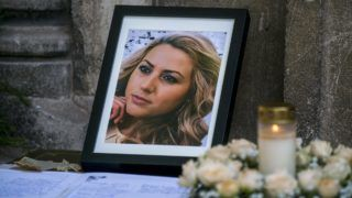 """A picture of the killed Bulgarian journalist Viktoria Marinova is seen during ger funeral in Holy Trinity Cathedral in Ruse, North East Bulgaria on October 12, 2018. - The body of 30-year-old Marinova -- who presented a current affairs talk programme called """"Detector"""" for the small TVN television channel -- was discovered on a riverside path in the northern Bulgarian town of Ruse on October 6. (Photo by Nikolay DOYCHINOV / AFP)"""