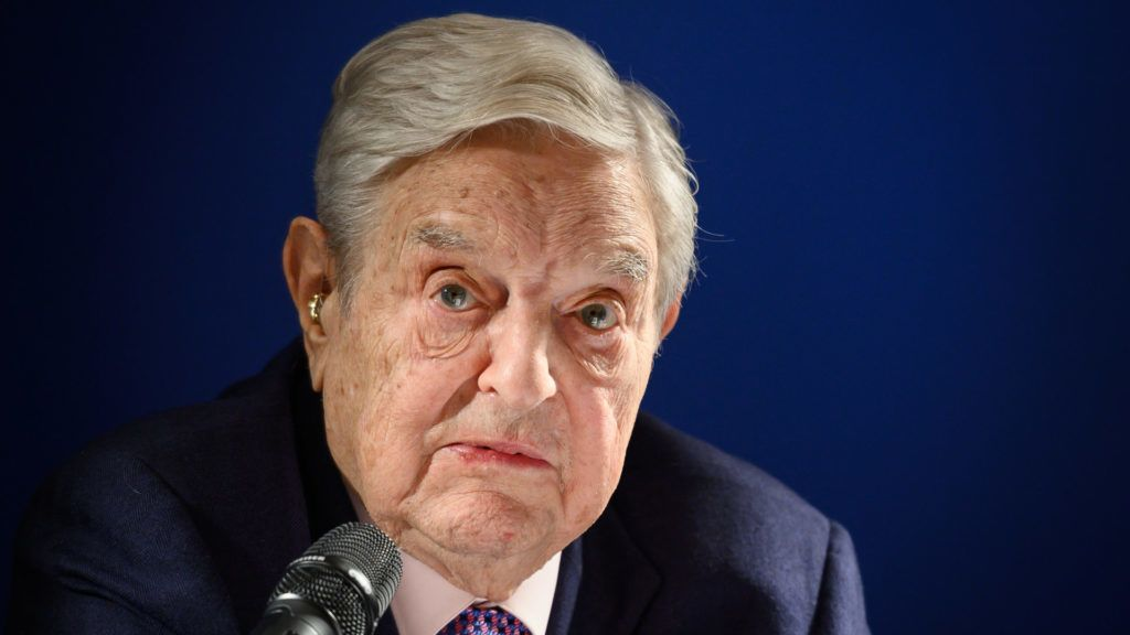 """Hungarian-born US investor and philanthropist George Soros delivers a speech on the sideline of the World Economic Forum (WEF) annual meeting, on January 24, 2019 in Davos, eastern Switzerland. - Billionaire investor George Soros said, on January 24, 2019 that Chinese President Xi Jinping was """"the most dangerous enemy"""" of free societies for presiding over a high-tech surveillance regime. (Photo by Fabrice COFFRINI / AFP)"""