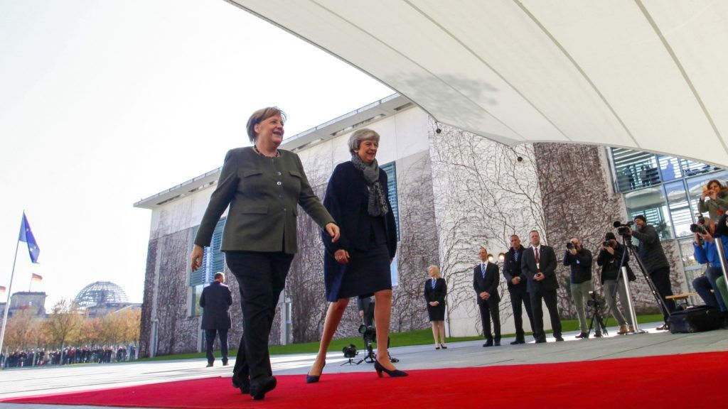 German Chancellor Angela Merkel (L) welcomes British Prime Minister Theresa May (2nd L) as she arrives at the Chancellery in Berlin on April 9, 2019. - German Chancellor Angela Merkel will host British Prime Minister Theresa May for talks, on the eve of a crucial EU summit when the British premier is hoping to convince the bloc to grant her a new Brexit extension to June 30. (Photo by MICHELE TANTUSSI / AFP)