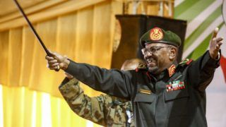 (FILES) In this file photo taken on February 13, 2019 Sudanese President Omar al-Bashir gestures with his walking cane as he addresses members of the Popular Defence Force (PDF), a paramilitary group, in the capital Khartoum. - Sudanese leader Omar al-Bashir, long wanted on genocide and war crimes charges, was finally brought down in a popular uprising by the very people he ruled with an iron fist for 30 years. One of Africa's longest-serving presidents, the 75-year-old had remained defiant in the face of months-long protests that left dozens of demonstrators dead in clashes with security forces. (Photo by ASHRAF SHAZLY / AFP)