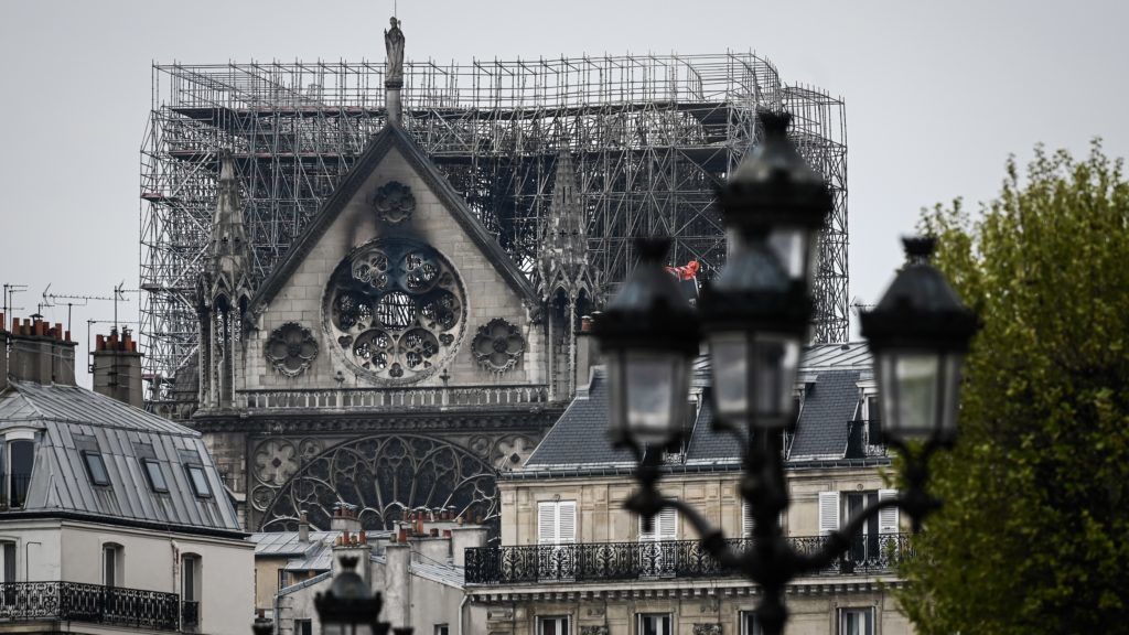 Scafolding which was errected for the renovation of the landmark Notre-Dame Cathedral, remains in place a day after a devastating fire destroyed the roof and other areas of the Gothic cathedral in central Paris on April 16, 2019. - A major fire broke out at the landmark Notre-Dame Cathedral in central Paris sending flames and huge clouds of grey smoke billowing into the sky on April 15, 2019 evening. French investigators probing the devastating blaze at Notre-Dame Cathedral questioned workers who were renovating the monument on April 16, 2019, as hundreds of millions of euros were pledged to restore the historic masterpiece. (Photo by Philippe LOPEZ / AFP)