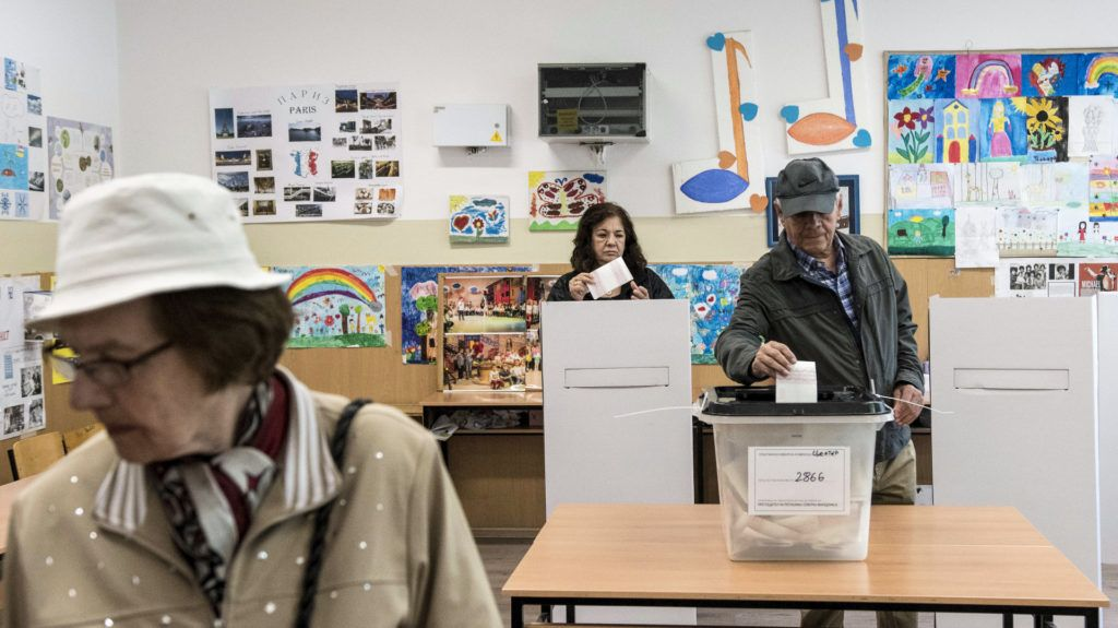 People casts their ballot for the presidential election at a polling station in Skopje on April 21, 2019. - North Macedonians voted for a new president on April 21, 2019 in the country's first election since changing its name, but there were fears that low turnout would render the poll invalid. (Photo by Robert ATANASOVSKI / AFP)
