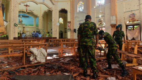 Security personnel inspect the interior of St. Sebastian's Church in Negombo on April 22, 2019, a day after the church was hit in series of bomb blasts targeting churches and luxury hotels in Sri Lanka. - The death toll from bomb blasts that ripped through churches and luxury hotels in Sri Lanka rose dramatically April 22 to 290 -- including dozens of foreigners -- as police announced new arrests over the country's worst attacks for more than a decade. (Photo by ISHARA S. KODIKARA / AFP)