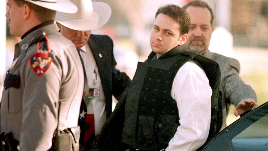 """(FILES) In this file photo taken on February 24, 1999 John William King (C) is escorted into the Jasper County Courthouse for the penalty phase of his capital murder trial in Jasper, Texas. - John William King, is set to be executed on April 24, 2019, barring a last-minute stay of execution, for the murder of James Byrd Jr. after he was dragged behind a pickup truck for over 3 miles in June 7, 1998. (Photo by PAUL BUCK / AFP) / """"The erroneous mention[s] appearing in the metadata of this photo by HO has been modified in AFP systems in the following manner: [executed on April 24, 2019] instead of [executed on April 23, 2019]. Please immediately remove the erroneous mention[s] from all your online services and delete it (them) from your servers. If you have been authorized by AFP to distribute it (them) to third parties, please ensure that the same actions are carried out by them. Failure to promptly comply with these instructions will entail liability on your part for any continued or post notification usage. Therefore we thank you very much for all your attention and prompt action. We are sorry for the inconvenience this notification may cause and remain at your disposal for any further information you may require."""""""