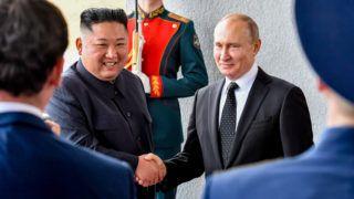 Russian President Vladimir Putin welcomes North Korean leader Kim Jong Un prior to their talks at the Far Eastern Federal University campus on Russky island in the far-eastern Russian port of Vladivostok on April 25, 2019. (Photo by Yuri KADOBNOV / AFP)
