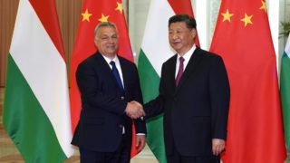 Hungarian Prime Minister Viktor Orban (L) shakes hands with Chinese President Xi Jinping during a meeting on April 25, 2019, as part of the second Belt and Road Forum (BRF) in Beijing. (Photo by Andrea VERDELLI / POOL / AFP)