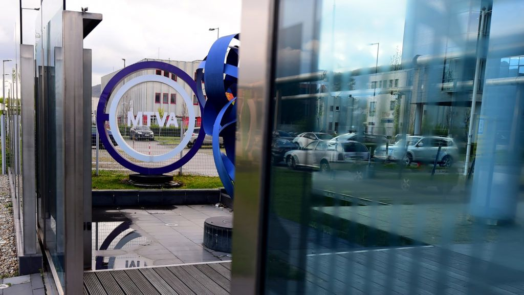 A logo of the Media Services and Support Trust Fund (MTVA) can be seen in front of their headquarter at the 3rd district of Budapest on April 7, 2017. - MTVA is the cooperation of the four public media services; with state radio , the 'Magyar Radio' (Hungarian Radio),  with the state televisions, the 'Magyar Televizio' (Hungarian Television) and the 'Duna Televizio' (Danube Television)  and the state news agency, the Magyar Tavirati Iroda'. (Photo by ATTILA KISBENEDEK / AFP)