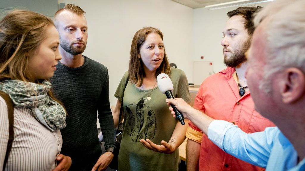 Donor children speak to press as they attend the court decision related to the case of late director of a fertility clinic Jan Karbaat, in Rotterdam on June 2, 2017. - A Dutch court ruled on June 2, 2017 that DNA tests could be carried out on the former director of a fertility clinic suspected of using his own sperm to father about 20 people. The group of 22 parents and children claim that the doctor, Jan Karbaat, may have used his own sperm instead of that of the chosen donor at a fertility clinic which he ran near Rotterdam until 2009. (Photo by Remko de Waal / ANP / AFP) / Netherlands OUT