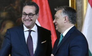 Austrian vice-chancellor Heinz-Christian Strache (L) and Hungarian Prime Minister Viktor Orban, react after their meeting in Vienna on January 30, 2018. (Photo by HANS PUNZ / APA / AFP) / Austria OUT