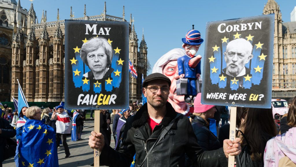 An anti-Brexit demonstrator holds placards depicting Theresa May and Jeremy Corbyn during a pro-EU protest outside the Houses of Parliament on 01 April, 2019 in London, England. Today, MPs hold a second round of indicative votes on alternative Brexit plans following a government defeat in the Commons last week as parliamentarians rejected Theresa May's EU Withdrawal Agreement for the third time. (Photo by WIktor Szymanowicz/NurPhoto)