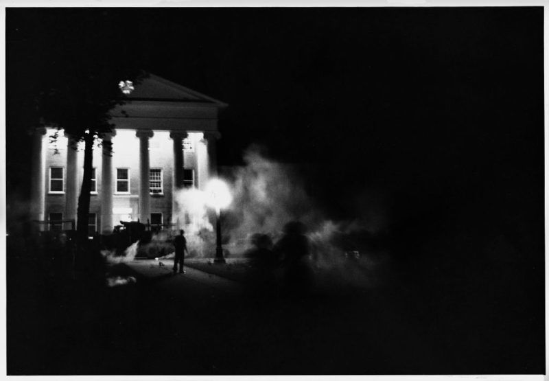 U.S. Marshals spray tear gas to disperse rioting students and segregationists on the campus of the University of Mississippi at Oxford. The riot started after it was announced that James Meredith, the first black student enrolled.
