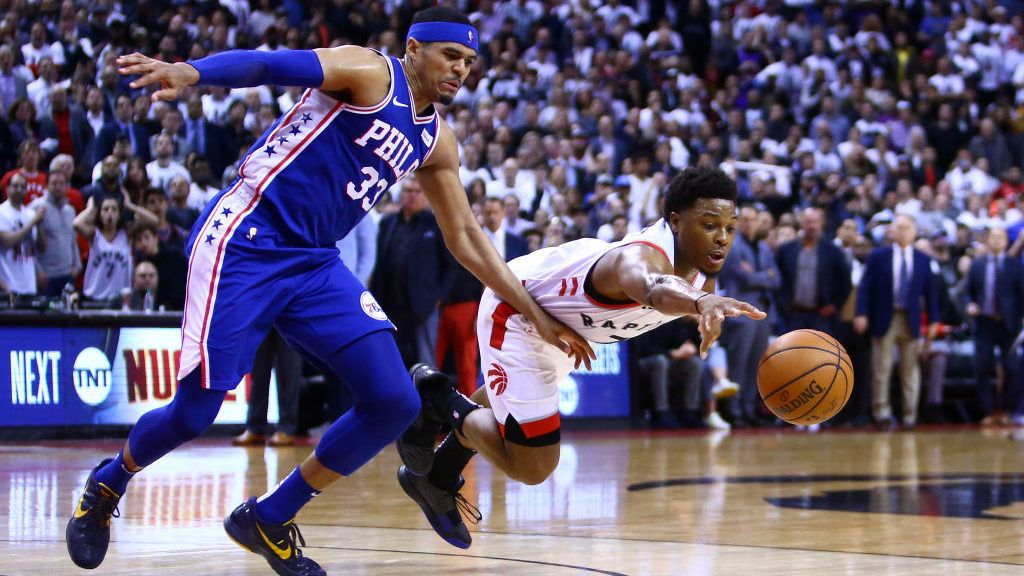 TORONTO, ON - APRIL 29:  Kyle Lowry #7 of the Toronto Raptors dives for the ball as Tobias Harris #33 of the Philadelphia 76ers defends during Game Two of the second round of the 2019 NBA Playoffs at Scotiabank Arena on April 29, 2019 in Toronto, Canada.  NOTE TO USER: User expressly acknowledges and agrees that, by downloading and or using this photograph, User is consenting to the terms and conditions of the Getty Images License Agreement.  (Photo by Vaughn Ridley/Getty Images)