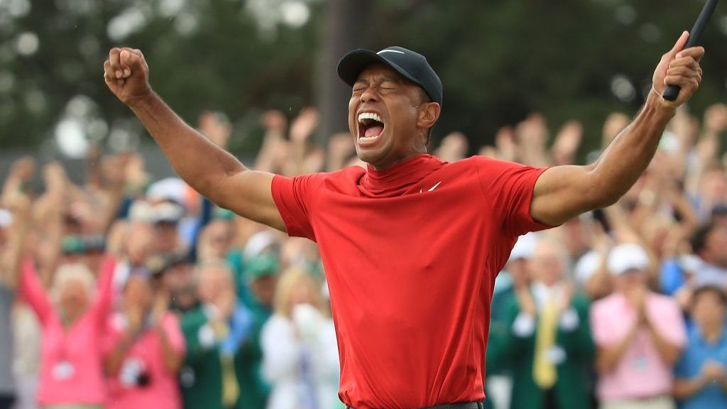 AUGUSTA, GEORGIA - APRIL 14: Tiger Woods of the United States celebrates after sinking his putt to win during the final round of the Masters at Augusta National Golf Club on April 14, 2019 in Augusta, Georgia. (Photo by Andrew Redington/Getty Images)