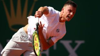 MONTE-CARLO, MONACO - APRIL 17: Marton Fucsovics of Hungary serves against Cameron Norrie of Great Britain in their second round match during day four of the Rolex Monte-Carlo Masters at Monte-Carlo Country Club on April 17, 2019 in Monte-Carlo, Monaco. (Photo by Clive Brunskill/Getty Images)