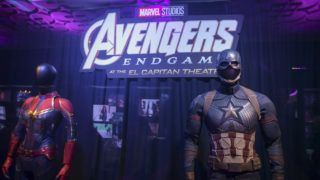 """LOS ANGELES, CALIFORNIA - APRIL 25: Captain Marvel's and Captain America's suits on display at the Marvel Studios's """"Avengers: Endgame"""" opening day marathon event at El Capitan Theatre on April 25, 2019 in Los Angeles, California. (Photo by Rodin Eckenroth/Getty Images)"""