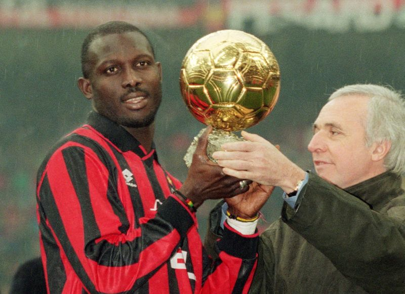 MILAN - JANUARY 5:  George Weah of AC Milan is presented the 'European Footballer of the Year' award before the Serie A match between AC Milan and Sampdoria held on January 5, 1996 at the San Siro, in Milan, Italy. AC Milan won the match 3-0. (Photo by Claudio Villa/ Grazia Neri/Getty Images)