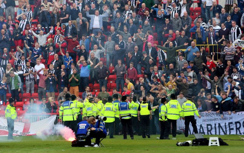 GATESHEAD, UNITED KINGDOM - MAY 04: Grimsby fans set off flares after Craig Disley scored their only goal during the Skrill Conference Premier Play Offs Semi Final second leg match between Gateshead and Grimsby Town at The Gateshead International Stadium on May 04, 2014 in Gateshead, England. (Photo by Ian Horrocks/Getty Images)