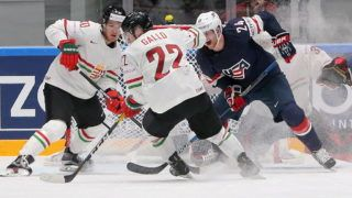 ST PETERSBURG, RUSSIA. MAY 13, 2016. Hungary's Zsombor Garat (10), Vilmos Gallo (22), and US player Hudson Fasching (24) in their 2016 IIHF Ice Hockey World Championships Group B Preliminary Round match at Yubileiny Arena. The United States won 5-1. Alexander Demianchuk/TASS (Photo by Alexander DemianchukTASS via Getty Images)