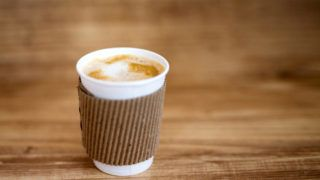 Paper cup of hot coffee