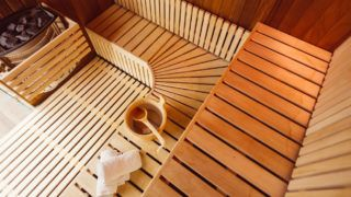 Interior of a wooden sauna room,with towels,bucket and ladle, view from the top