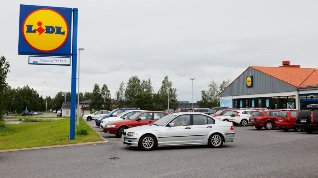 Tornio, Finland - July 9, 2015: Lidl shop exterior, sign and parked cars in front of the shop in Tornio.