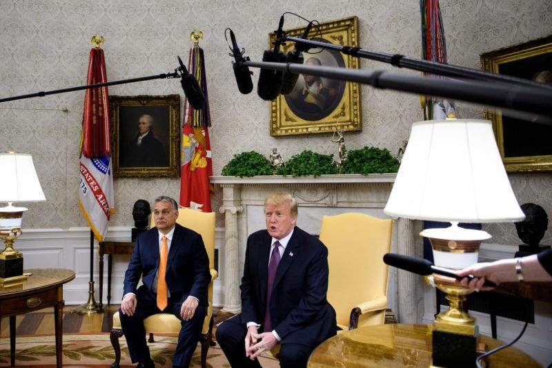 Hungary's Prime Minister Viktor Orban (L) listens while US President Donald Trump makes a statement for the press before a meeting in the Oval Office of the White House May 13, 2019, in Washington, DC. (Photo by Brendan Smialowski / AFP)