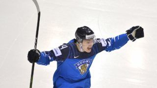 Finland's forward Kaapo Kakko celebrate scoring during the IIHF Men's Ice Hockey World Championships quarter-final match between Finland and Sweden on May 23, 2019 at the Steel Arena in Kosice, Slovakia. (Photo by JOE KLAMAR / AFP)