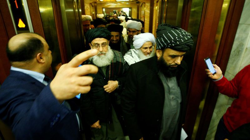 MOSCOW, RUSSIA - FEBRUARY 06: Head of Political Office of the Taliban Sher Mohammad Abbas Stanakzai gets on the elevator with related special representatives during the peace talks on Moscow format at the President Hotel in Moscow, Russia on February 6, 2019. The Taliban representatives met a number of non-government Afghan politicians in the Russian capital Moscow on for the landmark peace talks. Sefa Karacan / Anadolu Agency
