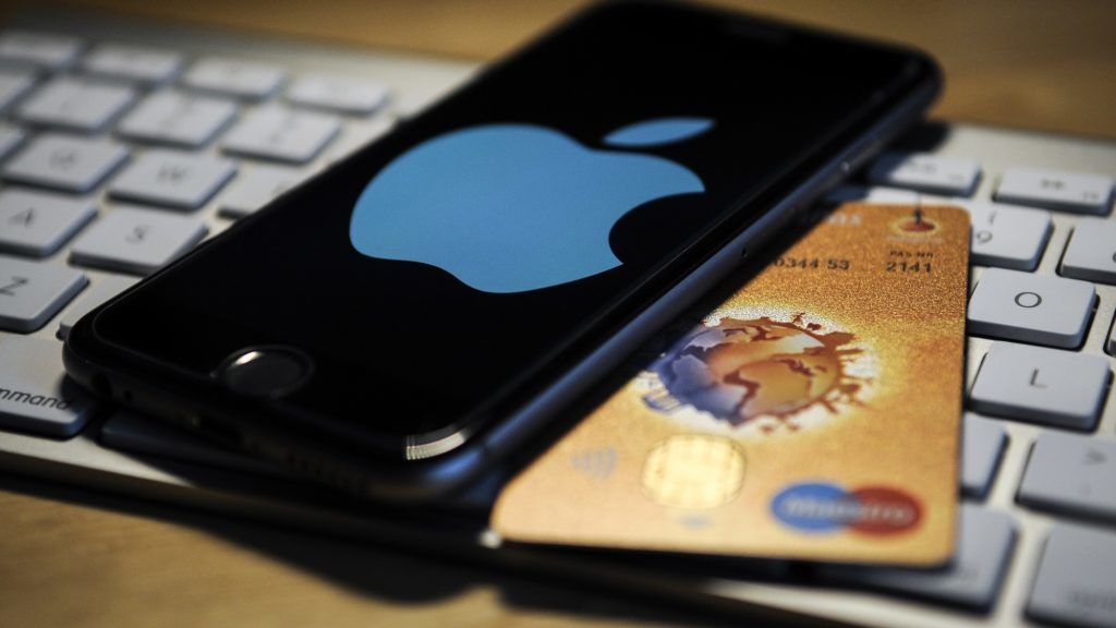 An iPhone and a debit card are seen on November 2, 2017. (Photo by Jaap Arriens/NurPhoto)