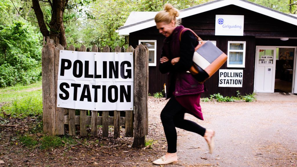 A woman leaves a polling station in the New Forest District Council town of New Milton in Hampshire, England, on May 2, 2019. Local council elections are today taking place across large swathes of England and the whole of Northern Ireland. In England, six mayoralties are also being contested. (Photo by David Cliff/NurPhoto)