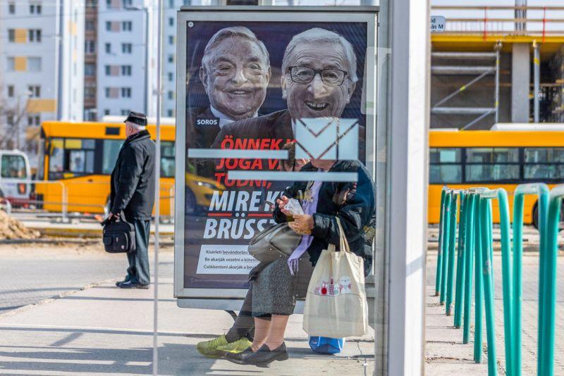 """Image: 73868809, A kormány újabb plakátkampányt indított 2019. februárban """"Önnek is joga van tudni, mire készül Brüsszel!"""" felirattal, Soros györgy és Jean-Claude Juncker arcképével., Place: Budapest, Hungary, License: Rights managed, Model Release: No or not aplicable, Property Release: Yes, Credit: smagpictures.com"""