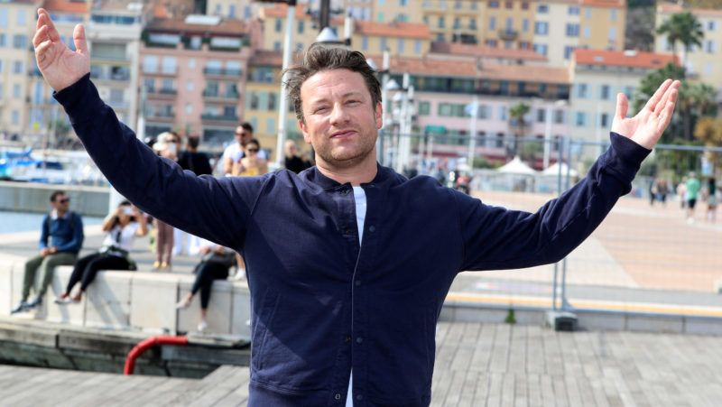 """British chef and activist Jamie Oliver, poses during a photocall for a TV serie """"Jamie Oliver"""" as part of the MIPCOM, the world's biggest television and entertainment market, on October 15, 2018 in Cannes, southeastern France. (Photo by VALERY HACHE / AFP)"""