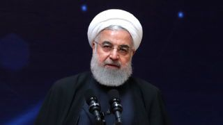 """A handout picture made available by the Iranian presidential office shows, Iranian President Hassan Rouhani delivering a speech during the """"nuclear technology day"""" in Tehran on April 9, 2019. - Rouhani said that the United States was the real """"leader of world terrorism"""" after Washington blacklisted Iran's Revolutionary Guards as a """"foreign terrorist organisation"""". """"Who are you to label revolutionary institutions as terrorists?"""" Rouhani asked in a speech broadcast live by state television. """"You want to use terrorist groups as tools against the nations of the region... you are the leader of world terrorism,"""" he said. (Photo by HO / Iranian Presidency / AFP) / === RESTRICTED TO EDITORIAL USE - MANDATORY CREDIT """"AFP PHOTO / HO / IRANIAN PRESIDENCY"""" - NO MARKETING NO ADVERTISING CAMPAIGNS - DISTRIBUTED AS A SERVICE TO CLIENTS ==="""