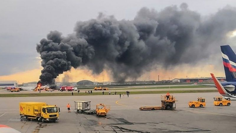 """This handout picture taken and realeased on May 5, 2019 by the Investigative Committee of Russia shows a fire of a Russian-made Superjet-100 at Sheremetyevo airport outside Moscow. - The Interfax agency reported that the plane, a Russian-made Superjet-100, had just taken off from Sheremetyevo airport on a domestic route when the crew issued a distress signal. 13 people died according to Russian agencies. (Photo by HO / RUSSIAN INVESTIGATIVE COMMITTEE / AFP) / RESTRICTED TO EDITORIAL USE - MANDATORY CREDIT """"AFP PHOTO / RUSSIAN INVESTIGATIVE COMMITTEE"""" - NO MARKETING NO ADVERTISING CAMPAIGNS - DISTRIBUTED AS A SERVICE TO CLIENTS"""