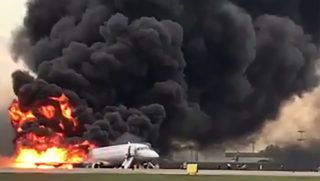 """This handout grab of a video obtained from the Instagram account of Gunkevitch on May 5, 2019, shows a fire of a Russian-made Superjet-100 at Sheremetyevo airport outside Moscow. - The Interfax agency reported that the plane, a Russian-made Superjet-100, had just taken off from Sheremetyevo airport on a domestic route when the crew issued a distress signal. 13 person died according to Russian agencies. (Photo by HO / INSTAGRAM / AFP) / RESTRICTED TO EDITORIAL USE - MANDATORY CREDIT """"AFP PHOTO / Gunkevitch"""" - NO MARKETING NO ADVERTISING CAMPAIGNS - DISTRIBUTED AS A SERVICE TO CLIENTS --- NO ARCHIVE"""