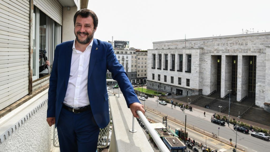 Italian Deputy Prime Minister and Interior Minister Matteo Salvini poses on the balcony of an appartment seized to the organized crime, facing Milan's courthouse, following its inauguration as new headquarters of Italy's National Agency for Seized and Confiscated Goods (ANBSC) on May 7, 2019 in Milan. - The ANBSC new headquarters is included among the assets confiscated by the Court of Milan in a criminal proceeding for money laundering against the mafia's organized crime.  (Photo by Miguel MEDINA / AFP)