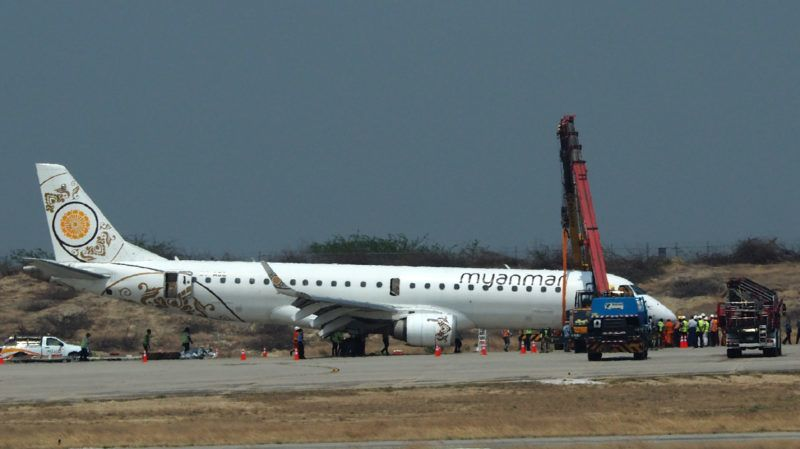 A general view shows a Myanmar National Airlines passenger plane after an emergency landing at Mandalay international airport on May 12, 2019. - A Myanmar pilot saved the day after his aircraft's landing gear failed, forcing the jet into an emergency landing with no front wheels on on May 12, an official said. (Photo by STR / AFP)