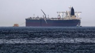 """A picture taken on May 13, 2019, shows the crude oil tanker, Amjad, which was one of two reported tankers that were damaged  in mysterious """"sabotage attacks"""", off the coast of the Gulf emirate of Fujairah. - Saudi Arabia said two of its oil tankers were damaged in mysterious """"sabotage attacks"""" in the Gulf as tensions soared in a region already shaken by a standoff between the United States and Iran. (Photo by KARIM SAHIB / AFP)"""