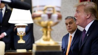 Hungary's Prime Minister Viktor Orban listens while US President Donald Trump speaks to the press before a meeting in the Oval Office of the White House on May 13, 2019, in Washington, DC. (Photo by Brendan Smialowski / AFP)
