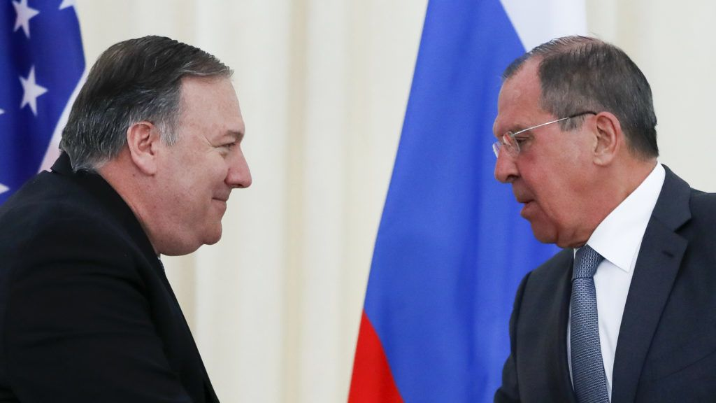 Russian Foreign Minister Sergei Lavrov and US Secretary of State Mike Pompeo shake hands at the end of a joint press conference following their talks in Sochi on May 14, 2019. (Photo by Pavel Golovkin / POOL / AFP)