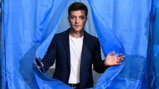 (FILES) In this file photo taken on April 21, 2019 Ukrainian comedian and then presidential candidate Volodymyr Zelensky walks out of a voting booth at a polling station during the second round of Ukraine's presidential election in Kiev. - Ukraine's parliament voted on May 16, 2019 to hold the inauguration of the newly elected president, comedian Volodymyr Zelensky, on May 20, 2019, after he wrangled with lawmakers over the date. (Photo by GENYA SAVILOV / AFP)