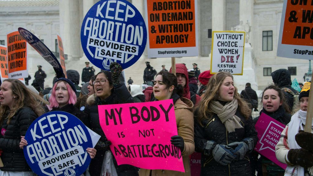 Pro-abortion activists gather in front of the US Supreme Court in Washington, DC, 0n January 22, 2016 as the country marks the 43rd anniversary of the Roe v Wasde Supreme Court decision which legalized abortion. (Photo by Nicholas Kamm / AFP)