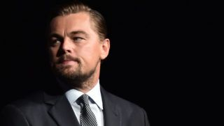 """US actor Leonardo DiCaprio looks on prior to speaking on stage during the Paris premiere of the documentary film """"Before the Flood"""" on October 17, 2016 at the Theatre du Chatelet in Paris. - US actor Leonardo DiCaprio has issued an impassioned call for immediate action on climate change in """"Before the Flood"""", a documentary film making its premiere in Paris on October 17. DiCaprio takes viewers around the world to meet experts and politicians in order to reveal the scale of the problem, its effects and the paths towards solutions. (Photo by CHRISTOPHE ARCHAMBAULT / POOL / AFP)"""
