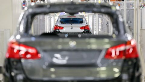 04 December 2018, Saxony, Leipzig: View through a BMW 2 Series Active Tourer (foreground grey) onto a BMW 1 Series five-door (white), in production at the BMW plant in Leipzig. Photo: Jan Woitas/dpa-Zentralbild/ZB