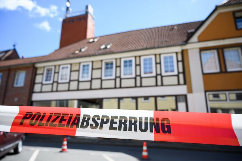 13 May 2019, Lower Saxony, Wittingen: A house is secured with police cordon tape. In connection with the Passau crossbow case, investigators have found two bodies in Lower Saxony. The dead women had been discovered in the apartment of one of the Passau victims in Wittingen (district of Gifhorn), a spokesman for the public prosecutor's office in Passau said on Monday. Photo: Christophe Gateau/dpa