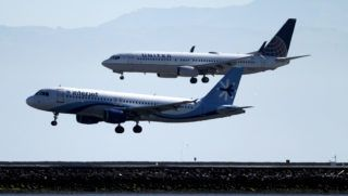 SAN FRANCISCO, CALIFORNIA - APRIL 24: A United Airlines Boeing 737 (TOP) lands next to an Interjet Airbus A320 at San Francisco International Airport on April 24, 2019 in San Francisco, California. Boeing's first quarter profits fell 21 percent following the Boeing 737 Max technical issues that have grounded all of the Max aircraft around the world. Two Boeing 737 Max 8 aircraft crashed in a six months period.   Justin Sullivan/Getty Images/AFP