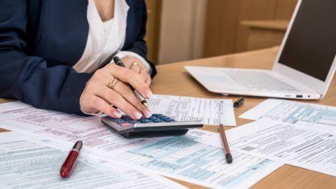 Woman filling US tax form